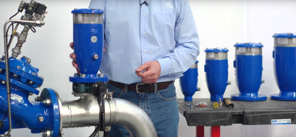 A Bermad Employee showcasing a water valve product
